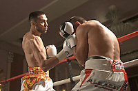 Sohail Ahmad (white/yellow/red shorts) defeats Radoslav Midev during a Boxing Show at the Sheraton Grand Hotel on 10th May 2018