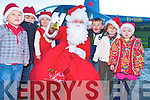 Pictured greeting Santa when he arrived by helicopter at Deenagh Montessoiri School, Kilcummin on Thursday morning were Ewan Evans, Cian Murray, Olwyn Evans, Shane Burke, Eimear Warren and Orianne McGillyciddy.