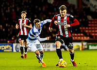Sheffield United's midfielder Lee Evans (20) goes past Queens Park Rangers midfielder Josh Scowen (11) xxxxduring the Sky Bet Championship match between Sheff United and Queens Park Rangers at Bramall Lane, Sheffield, England on 20 February 2018. Photo by Stephen Buckley / PRiME Media Images.