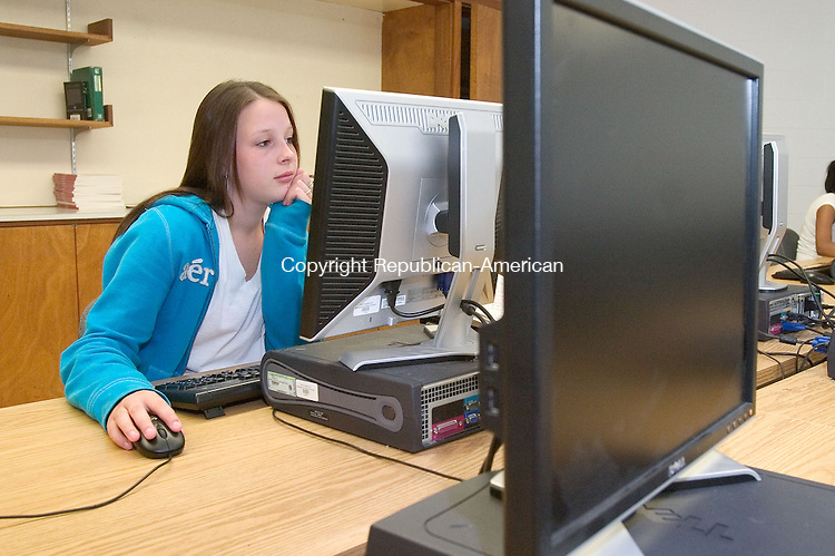NAUGATUCK, CT. 02 August 2010-090210SV04--Courtney Testone, 15, works on an online course in a computer lab at Naugatuck High School in Naugatuck Thursday. A new state law requires school districts with a dropout rate of 8 percent or higher to offer online credit recovery courses to students at risk of dropping out. <br /> Steven Valenti Republican-American