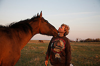 Karen Sussman receives a kiss from a horse in the Gila herd. Wild horses at International society for the Protection of Mustangs and Burros. Three herds are  cared for at the oldest wild horse organization founded in 1960.  Karen Sussman is the third president. Wild Horse Annie, Velma Johnston, was the first. Annie, along with Helen Reilly worked together for the passage of the 1971 Wild Horses and Burros Act to protect horses from slaughter and inhumane treatment.