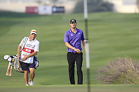 Chris Wood (ENG) and caddy Brendan McCarten walk onto the 18th green during Sunday's Final Round of the Commercial Bank Qatar Masters 2013 at Doha Golf Club, Doha, Qatar 26th January 2013 .Photo Eoin Clarke/www.golffile.ie