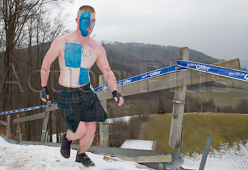 12.03.2016. Bischofsheim, Germany.  A participant of the extreme run Braveheart Battle with a painted face in Bischofsheim, Germany. Almost 2,700 runners have to manage a 30 kilometer track with 45 obstacles. The extreme run event leads through ice cold water, deep mud pits and hot fire obstacles. It is said to be one of the hardest in Europe.