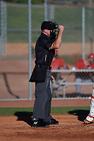 Home plate umpire Josh Williams calls a strike on a batter during an Arizona League game between the AZL Angels and AZL Giants Black at the Giants Baseball Complex on June 21, 2019 in Scottsdale, Arizona. AZL Angels defeated AZL Giants Black 6-3. (Zachary Lucy/Four Seam Images)