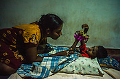 Mathumita reads bed-time stories to her son at her mother's house in Punaineeravi village in Kilinochchi in Northern Sri Lanka. Photo: Sanjit Das/Panos