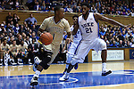31 December 2014: Wofford's Derrick Brooks (1) and Duke's Amile Jefferson (21). The Duke University Blue Devils hosted the Wofford College Terriers at Cameron Indoor Stadium in Durham, North Carolina in a 2014-16 NCAA Men's Basketball Division I game.