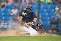 Helena Brewers catcher Payton Henry (33) applies a tag to J.J. Muno (2) of the Great Falls Voyagers as he slides into home plate at Centene Stadium on August 18, 2017 in Helena, Montana.  The Voyagers defeated the Brewers 10-7.  (Brian Westerholt/Four Seam Images)