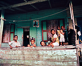 PANAMA, Bocas del Toro, a family hangs out on the front porch of their house at the end of the day, Central America