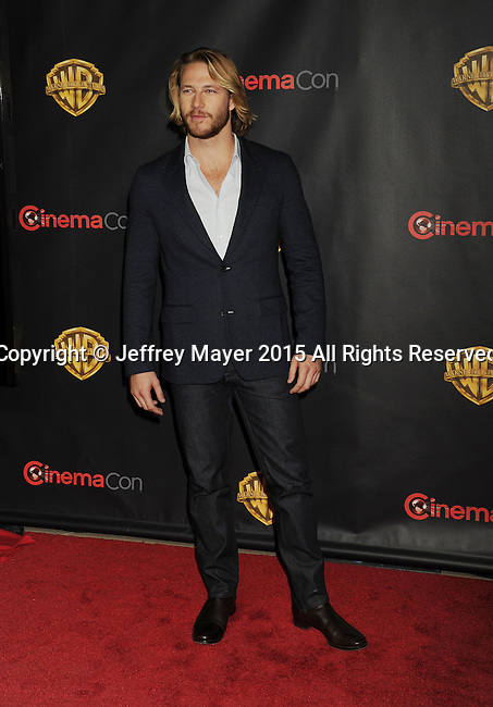 LAS VEGAS, CA - APRIL 21: Actor Luke Bracey arrives at Warner Bros. Pictures Invites You to ?The Big Picture at The Colosseum at Caesars Palace during CinemaCon, the official convention of the National Association of Theatre Owners, on April 21, 2015 in Las Vegas, Nevada.
