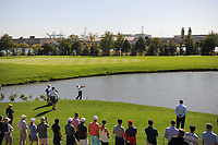 Hideki Matsuyama (JPN) hit his approach shot on 7 after Charl Schwartzel's (RSA) drive went in the water during round 1 foursomes of the 2017 President's Cup, Liberty National Golf Club, Jersey City, New Jersey, USA. 9/28/2017.<br /> Picture: Golffile   Ken Murray<br /> ll photo usage must carry mandatory copyright credit (&copy; Golffile   Ken Murray)