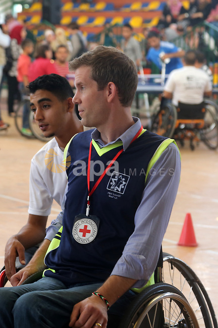 American coach Jess marc takes part in the closing ceremony of the wheelchairs basketball training camp organised by the International Committee of the Red Cross (ICRC), in Gaza city on june 2, 2016. Photo by Nidal Alwaheidi