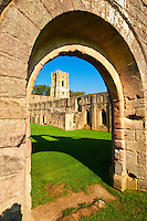 arched doorway into Fountains Abbey , founded in 1132, is one of the largest and best preserved ruined Cistercian monasteries in England. The ruined monastery is a focal point of England's most important 18th century Water, the Studley Royal Water Garden which is a UNESCO World Heritage Site. Near Ripon, North Yorkshire, England