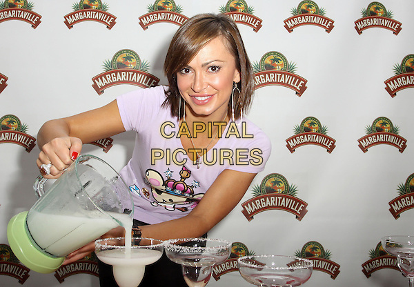 KARINA SMIRNOFF.Visits Gifting Services Inc held At El Gifting Services Showroom,  West Hollywood, California, USA, .24th April 2010..**EXCLUSIVE ALL ROUNDER**.half length purple t-shirt tee pouring drink jug magaritaville margarita cocktail drink drinks glasses .CAP/ADM/FS.©Faye Sadou/AdMedia/Capital Pictures.