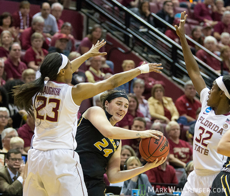 Florida State forward Ivey Slaughter, left, and Florida State guard Imani Wright try to trap Missouri guard Sierra Michaelis during the first half of a second-round game of the NCAA women's college basketball tournament in Tallahassee, Fla., Sunday, March 19, 2017. (AP Photo/Mark Wallheiser)
