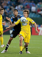 Steven Beitashour (left) and Guillermo Barros Schelotto (right) battle for control. The San Jose Earthquakes tied the Columbus Crew 2-2 at Buck Shaw Stadium in Santa Clara, California on June 2nd, 2010.