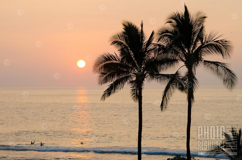 People enjoy the ocean and sunset at Hapuna Beach, Island of Hawai'i (Big Island).