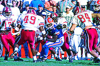 Jack Jackson (1), Benji Young (49), Thomas Pritchard (84), University of Florida Gators defeat the University of South Carolina Gamecocks 48-17 at Ben Hill Griffin Stadium, Florida Field, Gainseville, Florida, November 12, 1994 . (Photo by Brian Cleary/www.bcpix.com)