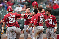 Clark Eagan (9) of the Arkansas Razorbacks is congratulated by his teammate after hitting a home run against the Texas Tech Red Raiders during game seven of the Shriners Hospitals for Children College Classic at Minute Maid Park on February 28, 2016 in Houston, Texas.  The Razorbacks defeated the Red Raiders 10-6.  (Brian Westerholt/Four Seam Images)