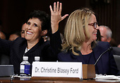 Professor Christine Blasey Ford (R), who has accused U.S. Supreme Court nominee Brett Kavanaugh of a sexual assault in 1982, smiles next to her attorney Debra Katz (L), who reacts at the conclusion of testimony before a Senate Judiciary Committee confirmation hearing for Kavanaugh on Capitol Hill in Washington, U.S., September 27, 2018. REUTERS/Jim Bourg