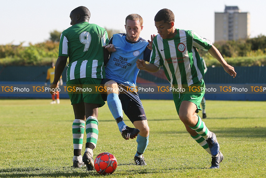 Dean Ellul of Barkingside squeezes between Michale Begg (L) and Taylor Nathaniel - Barkingside vs Bethnal Green United - Essex Senior League Football at Oakside - 02/10/11 - MANDATORY CREDIT: Gavin Ellis/TGSPHOTO - Self billing applies where appropriate - 0845 094 6026 - contact@tgsphoto.co.uk - NO UNPAID USE.