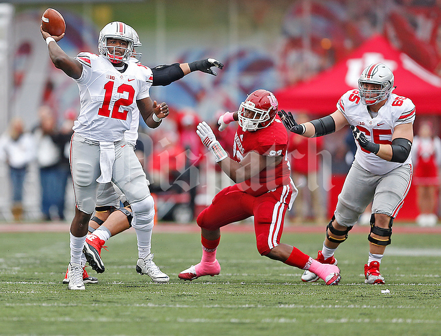 Ohio State Buckeyes quarterback Cardale Jones (12) looks for an open receiver downfield in first half play at Memorial Stadium on October 3, 2015. (Chris Russell/Dispatch Photo)