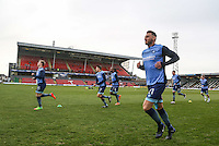 Wycombe players warm up ahead of the Sky Bet League 2 match between Grimsby Town and Wycombe Wanderers at Blundell Park, Cleethorpes, England on 4 March 2017. Photo by Andy Rowland / PRiME Media Images.