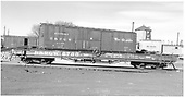 Side view of D&amp;RGW idler flatcar #6706 at Alamosa.  In the background are standard gauge boxcar #61665, boxcar #3579, outfit boxcar #04407 (sleeper) and pile driver #OB.<br /> D&amp;RGW  Alamosa, CO  Taken by Richardson, Robert W. - 10/30/1955