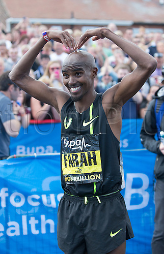 07.09.2014.  South Shields, England.  BUPA Great North Run. Mo Farah done his MoBot celebration after the race.