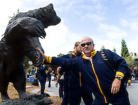 California head coach Jeff Tedford touches the bear statue before going inside the Memorial Stadium before the game against Southern Utah at Memorial Stadium in Berkeley, California on September 8th, 2012.   California Golden Bears defeated Southern Utah, 50-31.