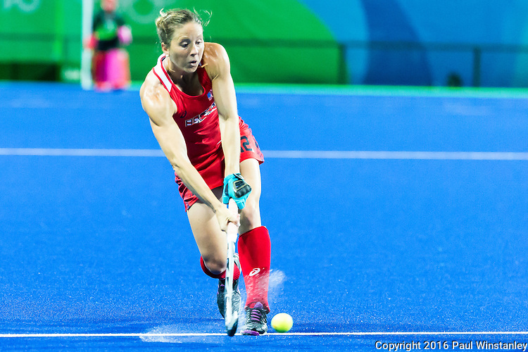 Julia Reinprecht #12 of United States passes during USA vs Japan in a Pool B game at the Rio 2016 Olympics at the Olympic Hockey Centre in Rio de Janeiro, Brazil.
