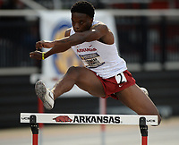 NWA Democrat-Gazette/ANDY SHUPE<br /> Arkansas' Travean Caldwell clears a hurdle as he competes Saturday, May 11, 2019, in the 400-meter hurdles during the SEC Outdoor Track and Field Championships at John McDonnell Field in Fayetteville. Visit nwadg.com/photos to see more photographs from the meet.