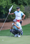 Bethesda, MD - June 25, 2016: John Huh (USA) prepares to shot a putt during Round 3 of professional play at the Quicken Loans National Tournament at the Congressional Country Club in Bethesda, MD, June 25, 2016.  (Photo by Elliott Brown/Media Images International)