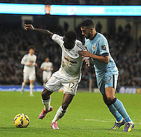 Picture: Andrew Roe/AHPIX LTD, Football, Barclays Premier League, Manchester City v Swansea City, 22/11/14, Etihad Stadium, K.O 3pm<br /> <br /> City's Gael Clichy keeps tight on Swansea's Nathan Dyer<br /> <br /> Andrew Roe>>>>>>>07826527594