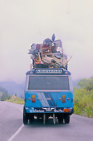 Local bus on the highway in the rain forest of the Amazon in Ecuador