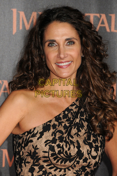 Melina Kanakaredes.The World Premiere of 'Immortals' held at The Nokia Theater Live in Los Angeles, California, USA..November 7th, 2011.headshot portrait black beige print one shoulder  .CAP/ADM/BP.©Byron Purvis/AdMedia/Capital Pictures.