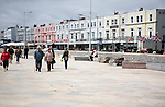 People walking on the seafront promenade at Weston super Mare, Somerset, England