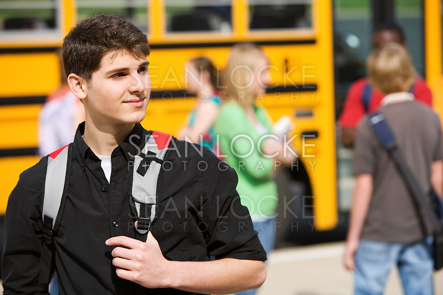 Series with multi-ethnic group of teenage students boarding and on a school bus.