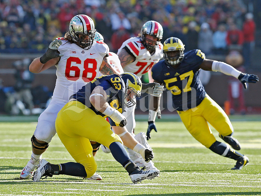Ohio State Buckeyes offensive linesman Taylor Decker (68) against Michigan Wolverines during their college football game at Michigan Stadium in Ann Arbor, Michigan on November 30, 2013.  (Dispatch photo by Kyle Robertson)