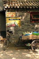 Bicycle rickshaws bring tourist through some of Beijing's oldest neighborhoods called hutongs. Many of the narrow residential alleyways have been demolished in the name of modernization, but in isolated pockets around the city, the sounds and smells of old Beijing are alive with authenticity. These charming alleyways provide travelers a fleeting glimpse at a simple and ancient way of life. Beijing's hutongs are a disappearing cultural treasure and a remnant of the city's 14th-century design. .