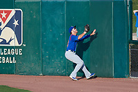 South Bend Cubs right fielder Brandon Hughes (19) tracks a fly ball at the fence during a game against the Kane County Cougars on July 21, 2018 at Northwestern Medicine Field in Geneva, Illinois.  South Bend defeated Kane County 4-2.  (Mike Janes/Four Seam Images)