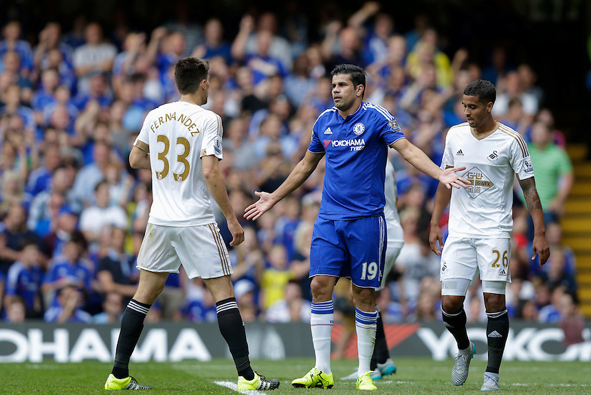 Chelsea's Diego Costa reacts after being brought down by Swansea City's Federico Fernandez and appealing for a penalty<br /> <br /> Photographer Craig Mercer/CameraSport<br /> <br /> Football - Barclays Premiership - Chelsea v Swansea City - Saturday 8th August 2015 - Stamford Bridge - London<br /> <br /> &copy; CameraSport - 43 Linden Ave. Countesthorpe. Leicester. England. LE8 5PG - Tel: +44 (0) 116 277 4147 - admin@camerasport.com - www.camerasport.com