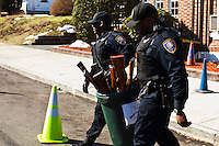 New Jersey, United States. 15th February 2013 -- NJ police officers carry some rifles to be organized on a truck after being acquired during the Gun Buyback program in New Jersey. Photo by Eduardo Munoz Alvarez / VIEWpress.
