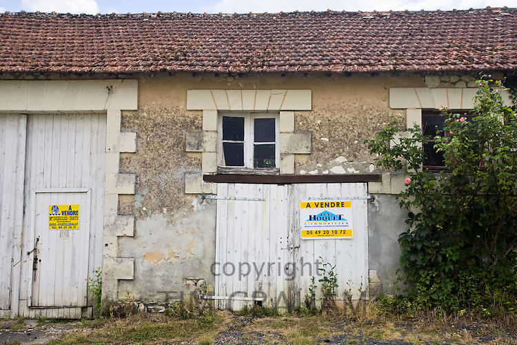 For Sale sign on period property for renovation at Serigny in the Loire Valley, France