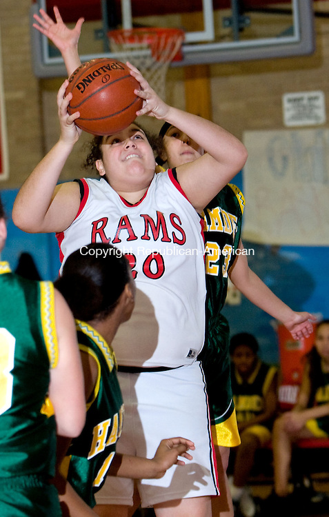 CHESHIRE, CT - 16 FEBRUARY 2009 -021609JT16-<br /> Cheshire's Nora Bahgat goes for a shot while under pressure from Hamden's #15 Takerra Williams, left, and #23 Lianna Carrero during Monday's game at Cheshire. The Rams lost, 71-58.<br /> Josalee Thrift Republican-American