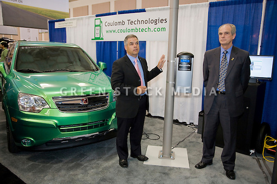 Richard Lowenthal, CEO, Coulomb Technologies, and Chuck Reed, Mayor of San Jose, announce new smart charging stations infrastructure for plug-in vehicles. ChargePoint charging stations will be attached to streetlight poles and other access points. Secure charging access can be purchased by plug-in vehicle drivers. Coulomb's ChargePoint Network includes public charging stations, a consumer subscription plan, and utility grid management technology. Opening day of the July 22-24 inaugural Plug-In 2008 Conference & Exposition: A Short Drive to Tomorrow in San Jose, CA. The event showcases the latest technological advances, market research and policy initiatives shaping the future of plug-in hybrid electric vehicles (PHEVs). Original photo is high-resolution (4368 x 2912 pixels).