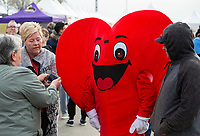 NWA Democrat-Gazette/BEN GOFF @NWABENGOFF<br /> Participants arrive Saturday, April 13, 2019, during the Northwest Arkansas Heart Walk starting from the Walmart Arkansas Music Pavilion in Rogers. This year is the 25th anniversary for the American Heart Association's annual walk with locations around the country. This year's Northwest Arkansas walk raised more than $1 million with donations still coming in as of Saturday morning, said to Lauren Wheeler with the American Heart Association Northwest Arkansas.
