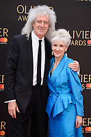 Brian May &amp; Anita Dobson arriving for the Olivier Awards 2018 at the Royal Albert Hall, London, UK. <br /> 08 April  2018<br /> Picture: Steve Vas/Featureflash/SilverHub 0208 004 5359 sales@silverhubmedia.com