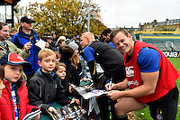 Chris Cook of Bath Rugby mingles and signs autographs with supporters at the end of the session. Bath Rugby Captain's Run on October 30, 2015 at the Recreation Ground in Bath, England. Photo by: Patrick Khachfe / Onside Images