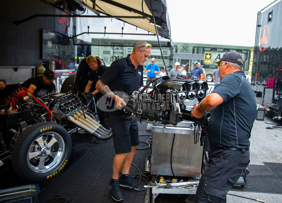 May 5, 2018; Commerce, GA, USA; Crew members for NHRA funny car driver Jonnie Lindberg during qualifying for the Southern Nationals at Atlanta Dragway. Mandatory Credit: Mark J. Rebilas-USA TODAY Sports