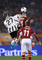 Calcio, Serie A: Roma vs Udinese. Roma, stadio Olimpico, 17 marzo 2014.<br /> From left, Udinese defender Widmer Silvan, of Switzerland, midfielder Emmanuel Badu, of Ghana, and AS Roma midfielder Radja Nainggolan, of Belgium, jump for the ball past AS Roma midfielder Rodrigo Taddei, of Brazil, right, during the Italian Serie A football match between AS Roma and Udinese at Rome's Olympic stadium, 17 March 2014.<br /> UPDATE IMAGES PRESS/Isabella Bonotto
